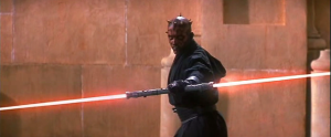 Darth Maul wielding his double light saber for the first time