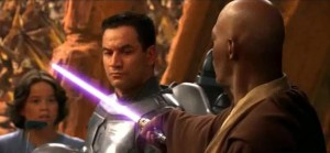 Mace Windu with light saber against Jango Fett as Boba Fett looks on