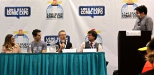 Stuart Immonen speaking while panelists look on (Picture by Jesse Nowlin)