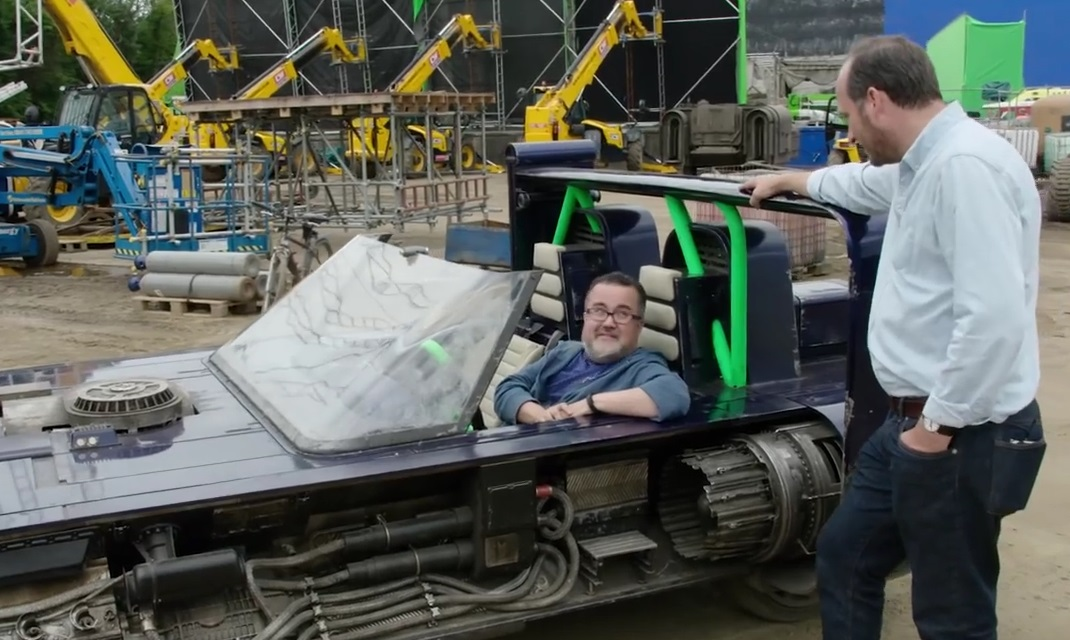 Pablo Hidalgo in the speeder that Han Solo drives in the beginning of Solo while Gary Tomkins looks on