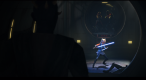 Maul emerges from the tunnel while Ahsoka is at the ready with her lightsabers
